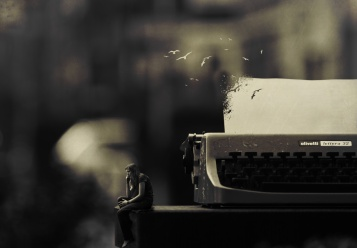 paperflyingfromtypewriter